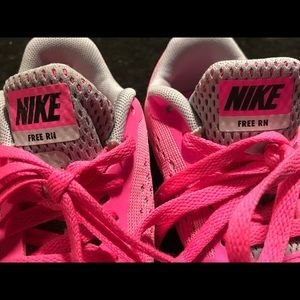 Nike pink girls running/tennis or tumble shoes.
